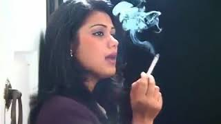 Indian woman smokes an all‑white cigarette