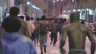 African migrants storm border into Spain