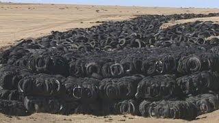 Businessman cleans up tire dump