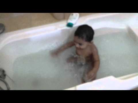 Indian baby playing in tub