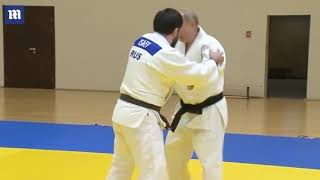 Putin takes part in training session with Russian judo champions