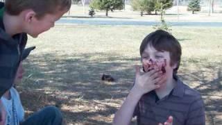 Kid eats dog poop