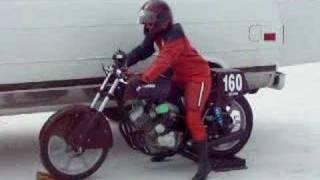 Woman starts her motorcycle.