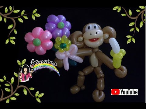CHANGO CON FLORES. MONKEY WITH FLOWERS .