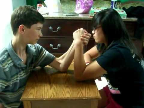Girl beats boy in arm wrestling Super funny hilarious
