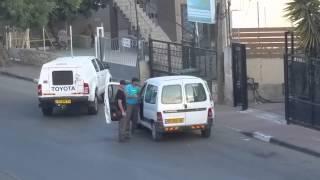 فيديو مطاردة بوليسية في كفر قرع  وهروب بعض راكبي السيارة