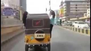 Girls having fun in Auto Rickshaw somewhere in Karachi city of Pakistan