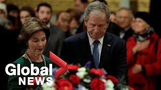 George W. Bush revisits his father, George H. W. Bush