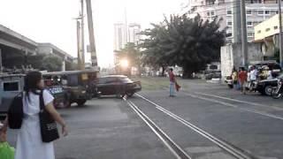 PNR Train #915 crossing the Pasay Road