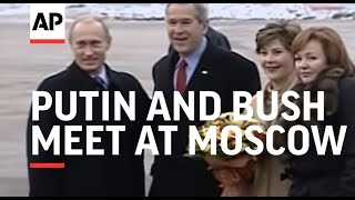 Putin and Bush meet at Moscow airport as US president heads to Asia