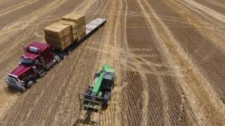 loading a truck with square bales Phantom 4 footage