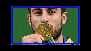 Olympic weightlifter to sell gold medal for iran