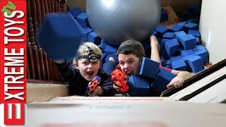 Box Fort Nerf Battle! Ethan Vs. Cole Nerf Attack in a Crazy Huge Cardboard Box Base