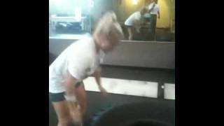 Female Fitness Model Flipping a 150 Pound Tire!