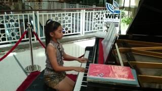 9 year old thai girl playing piano at Market Village Hua Hin