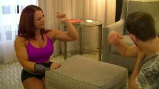 Amber Deluca weak arm wrestling with a guy