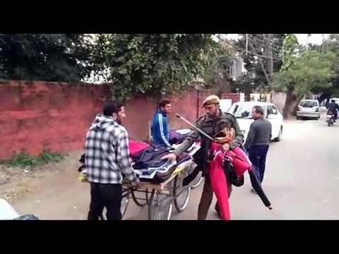 Shameful Police Officer looting Jackets from Road-Side Vendor | Jammu