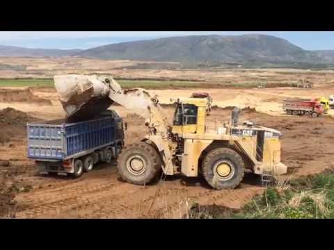 Caterpillar 990F With Huge Bucket Loading Trucks