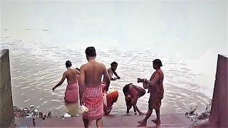 Regional religious Ganga nadi snan (Ganges river bath) on open public ghat for worship