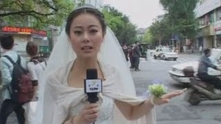 Dedicated reporter in China covers Sichuan earthquake in her wedding dress