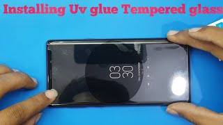 Installing uv glue Tempered glass on Curved Display phone with uv lamp