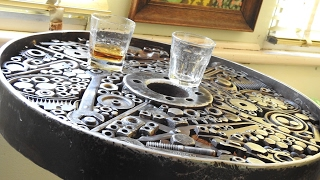 Metal Welded bar table made from scrap metal, leaf springs, iron wheel, spanners, bolts