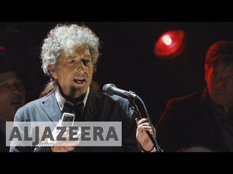 Bob Dylan collects Nobel Prize award
