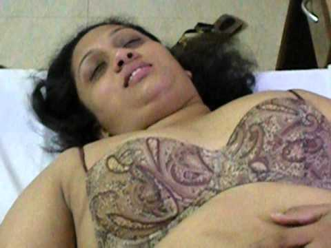Indian wife showing her assets to hubby