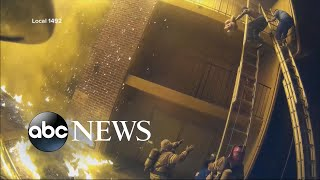 Helmet camera shows firefighters catching children thrown from burning building