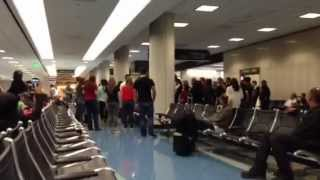 Airport Baggage Claim Random Christmas Choir - During Holiday Travels...
