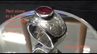 Red stone in a silver ring