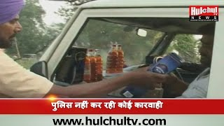 Whisky Sailing on Car By Contractor in A Kabaddi Match at Patiala