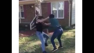 1 Black girl and 1 White girl fight