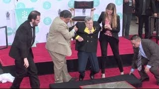 JERRY LEWIS supported by staffers when legs almost fail him