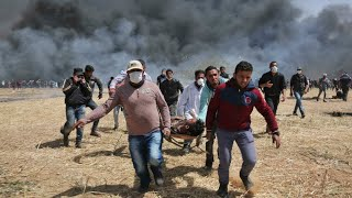 """أربعة قتلى ومئات الجرحى برصاص الجيش الإسرائيلي في مسيرة """"العودة الكبرى"""" في غزة"""