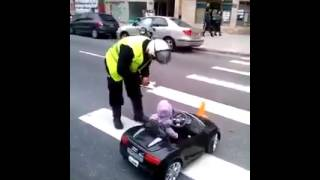 Police officer fines a small child because of driving the car on road...