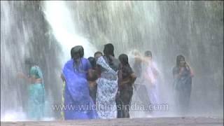 Ladies in sarees get wet under waterfalls in Kerala : Thirparappu