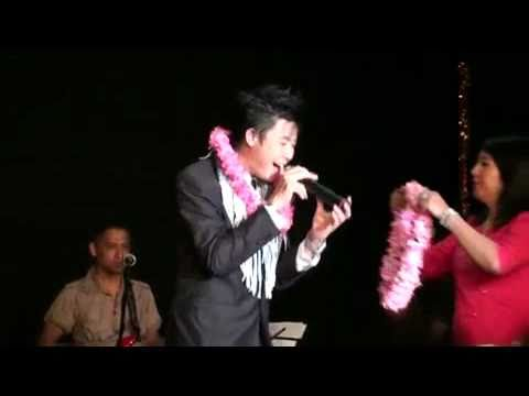 Nay Toe singing in Perth concert