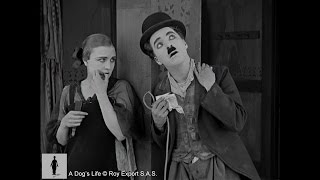Edna Purviance flirts with Charlie Chaplin - A Dog
