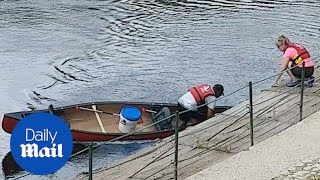 Canoeing fail: Man flips his boat and falls into the water - Daily Mail