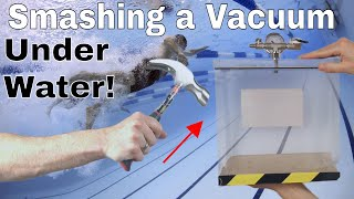Smashing a Vacuum Chamber Under Water—Is There a Bubble?