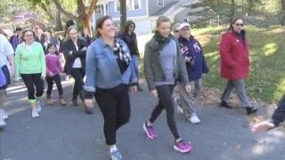 Hundreds march in yoga pants after complaint about apparel