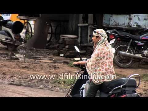 Muslim woman rides a scooter - Vadodara, Gujarat