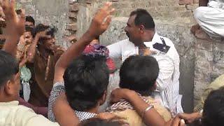 traffic warden beaten by public in Sargodha