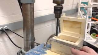 How to driill holes in the wood box to hold magnets
