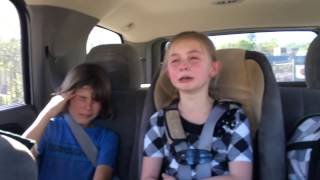 Little girl upset because her Big brother won