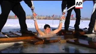 Orthodox Kyrgyz jump into frozen lakes and rivers to celebrate Epiphany