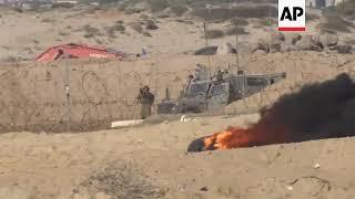 Scores hurt as Israel troops break up Gaza border and flotilla protest