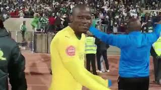 Bloem Celtic supporters sing for Mamelodi Sundowns players and coach Pitso Mosimane