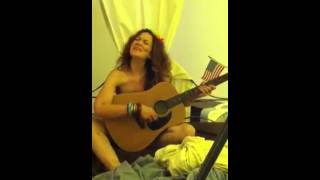 Sexy naked hippie woman, singing with guitar